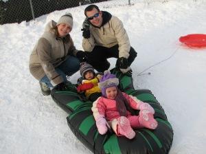 Tami, Steve, Tessa, and Davin sledding